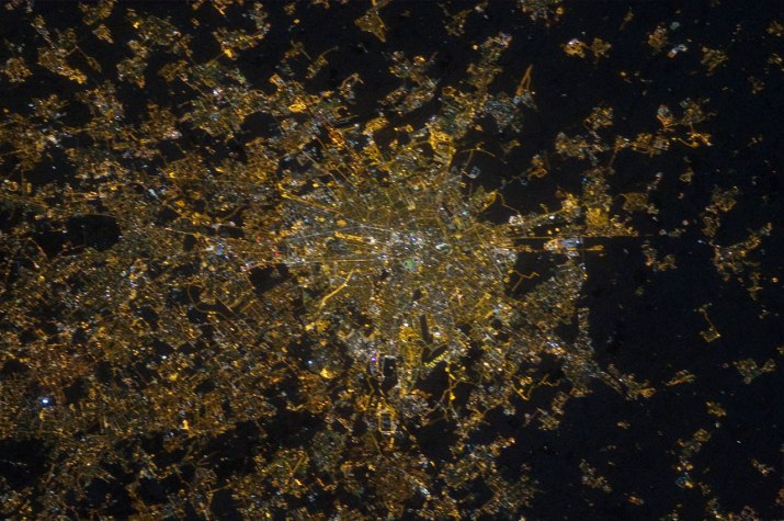 Image of Milan before the transition to LED technology. The many different streetlight colours visible indicate the use of different lighting technologies. The illumination level of Milan centre is similar to its suburbs. This image was taken by André Kuipers.