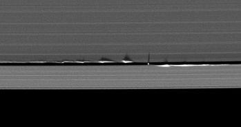 1200px-Daphnis_edge_wave_shadows
