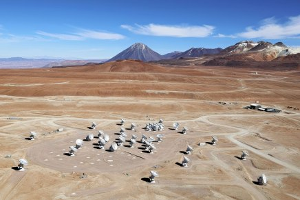 This image shows an aerial view of the Chajnantor Plateau, located at an altitude of 5000 meters in the Chilean Andes, where the array of ALMA antennas is located. The large antennas have a diameter of 12 metres, while 12 smaller antennas with a diameter of 7 metres make up the ALMA Compact Array (ACA). On the horizon, the main peaks from right to left are Cerro Chajnantor, Cerro Toco, and Juriques. This photo was taken in December 2012, four months prior to the ALMA inauguration.