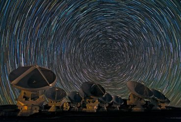 Babak Tafreshi, one of the ESO Photo Ambassadors, has captured the antennas of the Atacama Large Millimeter/submillimeter Array (ALMA) under the southern sky in another breathtaking image. The dramatic whorls of stars in the sky are reminiscent of van Gogh's Starry Night, or — for science fiction fans — perhaps the view from a spacecraft about to enter hyperspace. In reality, though, they show the rotation of the Earth, revealed by the photograph's long exposure. In the southern hemisphere, as the Earth turns, the stars appear to move in circles around the south celestial pole, which lies in the dim constellation of Octans (The Octant), between the more famous Southern Cross and the Magellanic Clouds. With a long enough exposure, the stars mark out circular trails as they move. The photograph was taken on the Chajnantor Plateau, at an altitude of 5000 metres in the Chilean Andes. This is the site of the ALMA telescope, whose antennas can be seen in the foreground. ALMA is the most powerful telescope for observing the cool Universe — molecular gas and dust, as well as the relic radiation of the Big Bang. When ALMA construction is complete in 2013, the telescope will have 54 of these 12-metre-diameter antennas, and twelve 7-metre antennas. However, early scientific observations with a partial array already began in 2011. Even though it is not fully constructed, the telescope is already producing outstanding results, outperforming all other telescopes of its kind. Some of the antennas are blurred in the photograph, as the telescope was in operation and moving during the shot. ALMA, an international astronomy facility, is a partnership of Europe, North America and East Asia in cooperation with the Republic of Chile. ALMA construction and operations are led on behalf of Europe by ESO, on behalf of North America by the National Radio Astronomy Observatory (NRAO), and on behalf of East Asia by the National Astronomical Observatory of Japan (NAOJ). The Joint ALMA