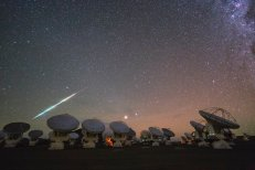 This beautiful new image, taken during a time-lapse set at the Atacama Large Millimeter/submillimeter Array (ALMA) is another dramatic Ultra High Definition photograph from the ESO Ultra HD Expedition. ALMA, located at 5000 metres above sea level on the remote and empty Chajnantor Plateau in the Chilean Andes, marks the second destination for the four ESO Photo Ambassadors [1] on their 17-day trip. The ambassadors are equipped with state-of-the-art Ultra HD tools to help them capture the true majesty of sights like the one pictured here [2] [3]. Some of the 66 high-precision antennas that comprise ALMA are visible here, with dishes pointed aloft, studying the cold clouds in interstellar space, and peering deep into the past at our mysterious cosmic origins. The spectacular javelin of light over the ALMA array is a shooting star, slicing through the image in a vivid streak of colours. Emerald green, golden and faint crimson hues blaze brightly as the meteor burns up as it enters the Earth's atmosphere and makes its fiery voyage across the sky. As the high-speed fireball — which is, in reality, a small grain of rock from interplanetary space — interacts with the atmosphere it heats up, vapourising the surface layers of the meteor, which are left behind in a glowing trail. These trails disappear in just a few seconds, but are captured here at the click of a button. The brightest star in the constellation of Virgo (The Virgin), known as Spica, and our neighbouring planet Mars glow brightly in the centre of the image — cosmic spectators to this fiery descent as they rise above the horizon. The Ultra HD Expedition began in Santiago, Chile, on 25 March 2014. This image was taken on the team's eighth night on the Chajnantor Plateau. They are currently at La Silla Observatory, ESO's first astronomical installation in Chile, and tomorrow, after one last night, they will finally make the long journey home. Free Ultra HD content gained from this expedition will so