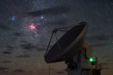 In this wonderful high definition, singe-exposure image taken during the ESO Ultra HD Expedition, three deep sky objects seem to shine in front of the dish of one of the Atacama Large Millimeter/submillimeter Array (ALMA) high-precision antennas. The most striking feature is the reddish Carina Nebula, also known as NGC 3372. It is a large cloud of gas, mostly hydrogen, in which star formation has recently taken place. The short-lived massive blue stars forged within the nebula emit copious amounts of ultraviolet radiation, which then ionises the surrounding gas and causes the hydrogen atoms to glow with a characteristic red colour. Eventually supernova explosions and strong stellar winds from the most massive stars will disperse the gas of the Carina Nebula, leaving behind one or more clusters of stars. Two such star clusters, known as NGC 3532 and IC 2602, can be seen respectively to the top right and top left of the Carina Nebula in this image. The three celestial objects belong to the constellation of Carina (The Keel) and were first catalogued by the French astronomer Nicolas Louis de Lacaille. They look close to one another in this image, but actually their distances from us are very different. IC 2602 lies less than 500 light-years from Earth, NGC 3532 is around 1300 light-years away and the Carina Nebula is thought to lie up to 10 000 light-years away.