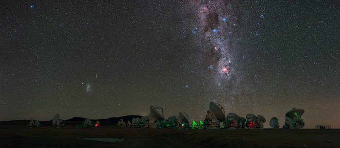 Antennas of the Atacama Large Millimeter/submillimeter Array (ALMA), on the Chajnantor Plateau, 5000m above sea level are seen in this UHD panorama. The Milky Way can be seen to stretch high above with Eta Carinae Nebula, a bright emission nebula, shown giving off its fiery red glow. Taken during the ESO Ultra HD Expedition.