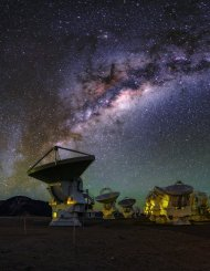This colourful view of the ALMA array shows our Milky Way galaxy shining high above the antennas. The array lets astronomers address some of the deepest questions of our cosmic origins.